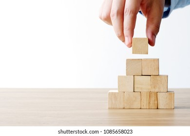 Hand holding blank wooden cubes, business concept background, mock up, template