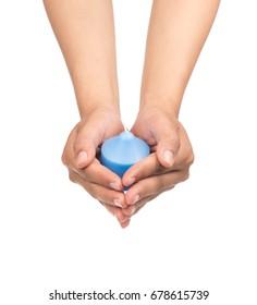 hand holding blue candle isolated on white background
