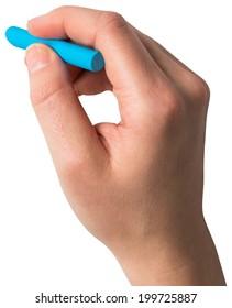 Hand holding blue chalk on white background