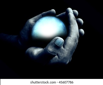 Hand holding blue crystal ball