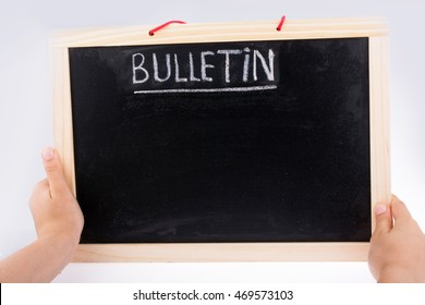Hand holding the board  with the title of bulletin