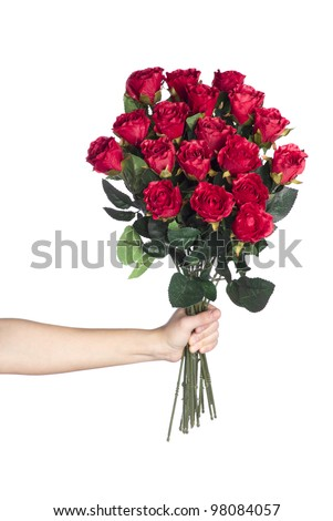 Hand holding bouquet of red roses over white background