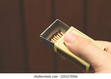 A hand holding a box of matches. Arson concept image.