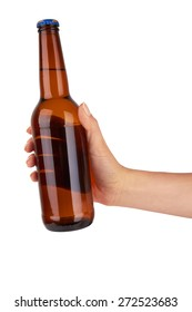 hand holding a brown beer bottle without label isolated on white background