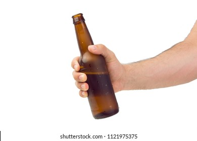 Hand Holding Brown Ice Cold Wet Condensated Lager Beer Bottle With Beer And Foam Inside Isolated On White