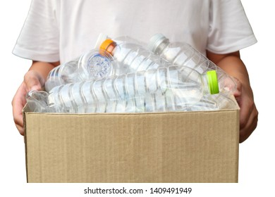 Hand holding brown recycle garbage box with plastic bottles isolated on white background
