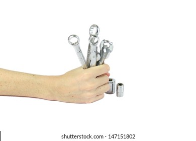Hand holding a bunch of working tools