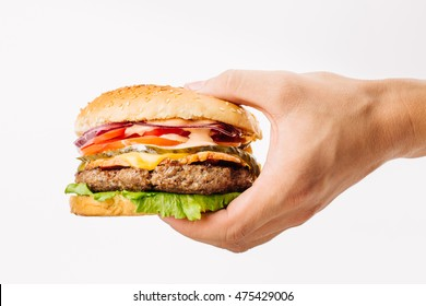 Hand holding a burger on white background. eating and healthy concept