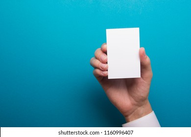 Hand holding business card blank on abstract background