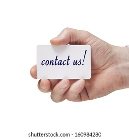 hand holding business card with contact us text