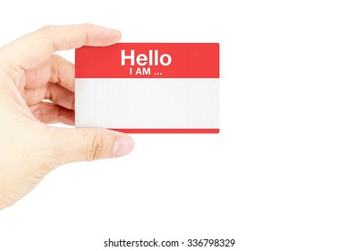 """Hand holding business card with """"Hello I am ..."""" with white background."""