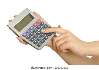 Hand holding calculator on white