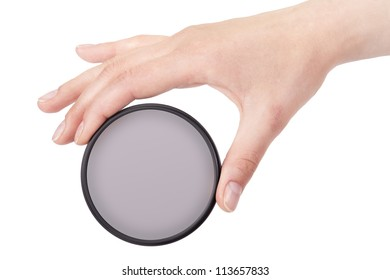 hand holding camera filter isolated on a white background