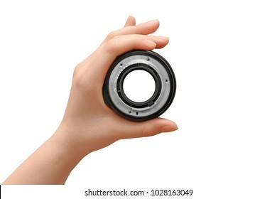 Hand holding camera lens on white background