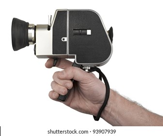 Hand holding a camera super 8 isolated on white