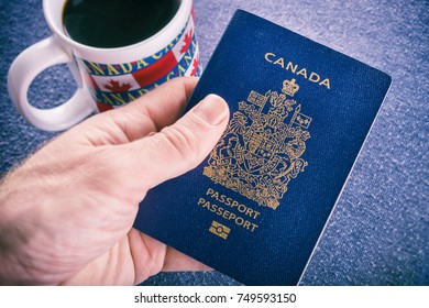 Hand holding a canadian passport