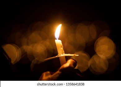 Hand holding candle