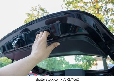 Hand holding  the car back door  with Hatchback cars