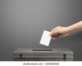 hand holding card for election vote.
