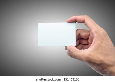 Hand holding card with empty space.