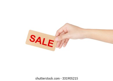 """Hand holding card with red word of """"Sale"""" isolated on white with clipping path."""