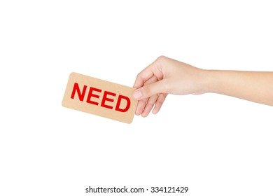 """Hand holding card with red word of """"Need"""" isolated on white with clipping path."""