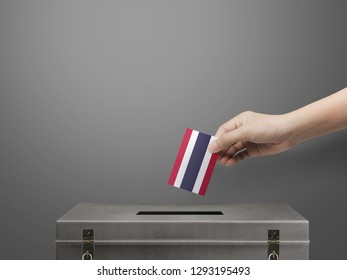 hand holding card thailand flag for election vote.