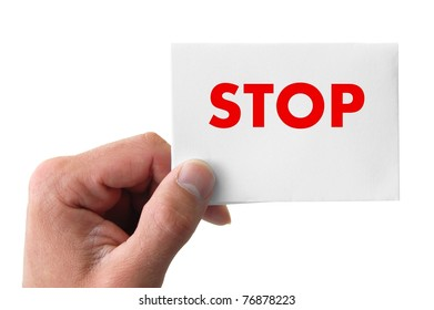 hand holding a card with the word stop