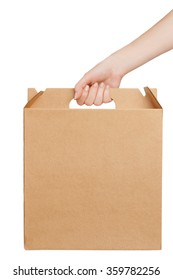 Hand holding a cardboard box isolated on white background with copy space