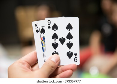 hand holding cards playing card game