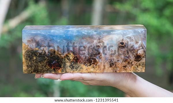 Hand Holding Casting Epoxy Resin Stabilizing Stock Photo