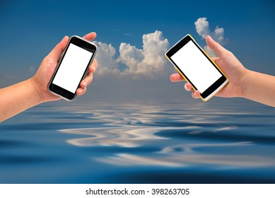 hand holding cell phone on sky-clouds background.