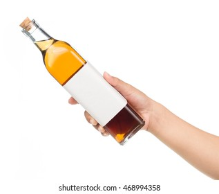 hand holding champagne bottle Isolated on white background