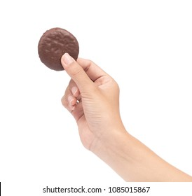 hand holding Chocolate brownie cookie Isolated on a White Background.