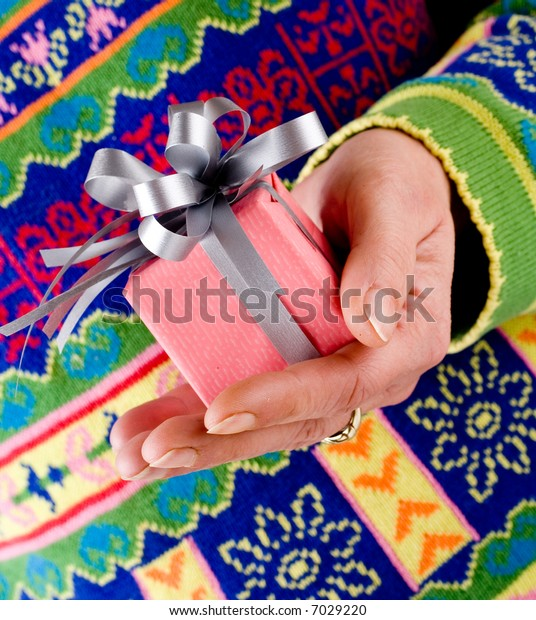 Hand holding a Christmas present