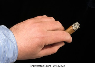 hand holding a cigar over black