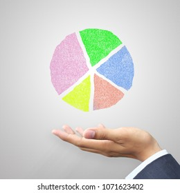 Hand holding circle chart