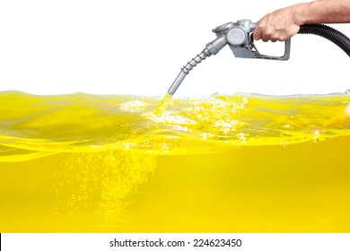 Hand holding a classic fuel nozzle pumping a gasoline fuel liquid in a tank of oil Industry isolated on white background with clipping path
