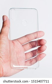 Hand holding clear smartphone case on white background