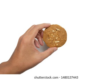 Hand holding Coffee cookie with almond isolated on white background.