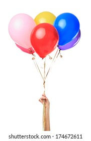 Hand holding colorful balloons isolated on white background