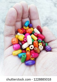 A hand Holding Colorful Beads