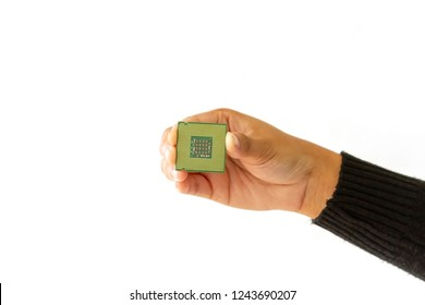 Hand holding computer processor (CPU), isolated on white background.