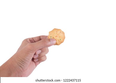 Hand holding cookies isolated  on white background.