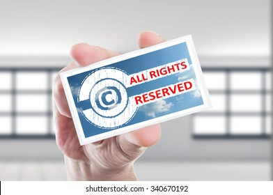 Hand holding copyright all rights reserved concept card
