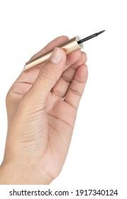 Hand holding Cosmetic eyeliner isolated on white background