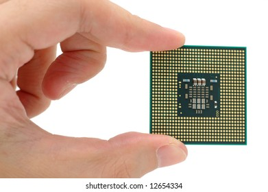 Hand holding a CPU in isolated white blackground