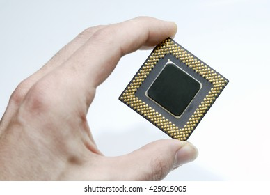 Hand holding a CPU in isolated white background
