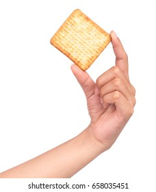 hand holding crackers snack bread isolated on a white background