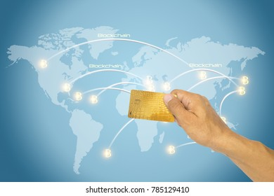 Hand holding credit bank card to buy bitcoin and block chain with connexions on a world map. Finance and crypto currency security concept